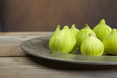 Green fresh figs in a plate Stock Photos