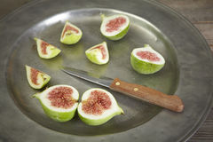Green fresh figs in a plate Stock Images