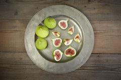 Green fresh figs in a plate Stock Image