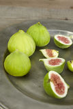 Green fresh figs in a plate Royalty Free Stock Image