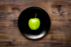 Green fresh food with apple on plate for fitness diet on wooden table background top view. Green fresh food with apple on plate for fitness diet on wooden Royalty Free Stock Photos