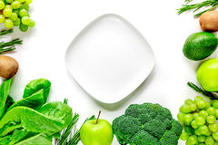 Green fresh food for fitness diet on white table background top view space for text Royalty Free Stock Images