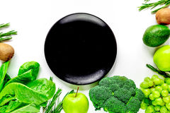 Green fresh food for fitness diet on white table background top view space for text Stock Photography