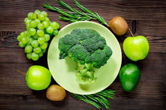 Green fresh food for fitness diet on wooden table background top view. Green fresh food for fitness diet on wooden kitchen table background top view Stock Image