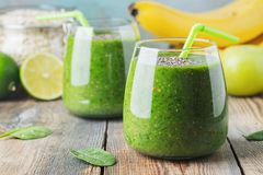 Green fresh healthy smoothie with fruits and vegetables.  royalty free stock photo