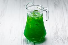 Green fresh homemade lemonade drink in a jar royalty free stock photography