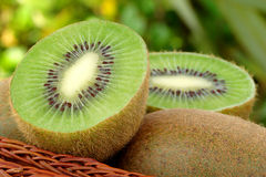 Green fresh kiwis. Delicious fresh kiwis with natural background royalty free stock photos