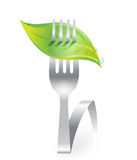Green fresh leaf on fork Stock Photography