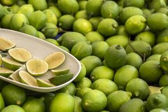 Green fresh lemon lime texture background / pile of lime lemon for sale in the market.  royalty free stock images