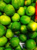 Green fresh limes in a basket at the market royalty free stock photos