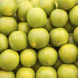 Green fresh limes stapled at the market Royalty Free Stock Photography