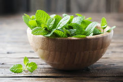 Green fresh mint om the wooden table Royalty Free Stock Photo