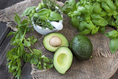 Green fresh organic vegetables on wooden board stock photos