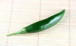 Green fresh paprika on bamboo background. Stock Photo