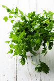 Green fresh parsley on the wooden table Royalty Free Stock Photography