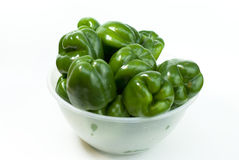 Green fresh peppers on the white background Stock Photo