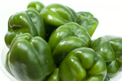 Green fresh peppers on white background Royalty Free Stock Photo