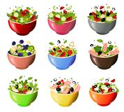 Green fresh salad of their various tasty vegetables in color bowls. royalty free stock images