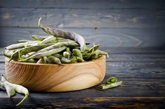 Green fresh soybeans on wood background Royalty Free Stock Photo