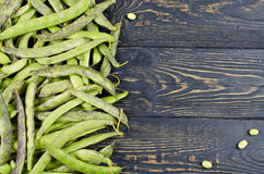 Green fresh soybeans on wood background Royalty Free Stock Images