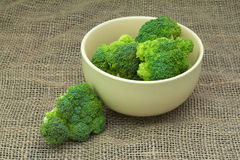 Green fresh vegetables. Chopped broccoli in a bowl on the tablecloth Royalty Free Stock Image