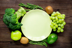 Green fresh vegetables and fruits for healthy salad on wooden table background top view mockup. Green fresh vegetables and fruits for healthy salad on wooden Stock Photography