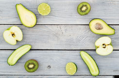 Green fresh vegetables on a white wooden table. Top view Royalty Free Stock Photo