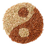Green and fried buckwheat forming a yin yang symbol Stock Image