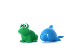 Green frog and blue dolphin children's toys Royalty Free Stock Photo