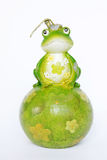Green Frog Candle. Decorated with flowers seating on a green ball isolated on white background Royalty Free Stock Photo