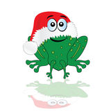 Green frog with christmas red hat Royalty Free Stock Photography