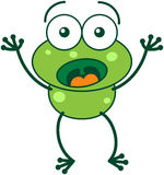Green frog looking surprised and scared Stock Photo