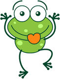 Green frog making funny faces Stock Image