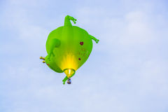Green frog prince hot air balloon. Leisure flight of hot air balloon in blue sky Stock Photos