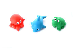 Green frog, red octopus blue dolphin children's toys Royalty Free Stock Photo