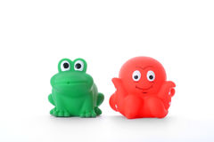 Green frog and red octopus children's toys Stock Photography