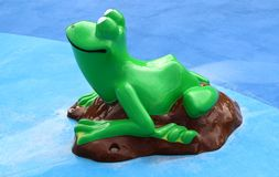 Green Frog At A Splash Park Royalty Free Stock Images