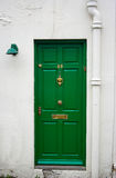 Green front door. The picture was taken in London Stock Image