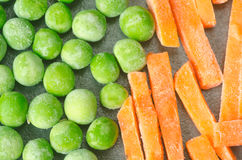 Green frozen peas and carrots Royalty Free Stock Photos