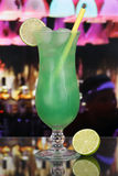 Green fruit cocktail in a bar or club Stock Image