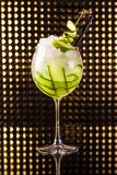 Green fruit cocktail with cucumber in tall round glass royalty free stock photography