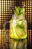 Green fruit cocktail lemonade with fresh cucumber in vintage jar stock photos
