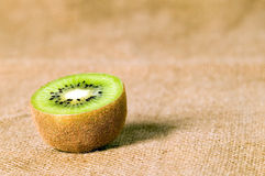 Green fruit kiwi on brown background Royalty Free Stock Image