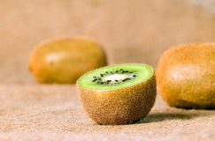 Green fruit kiwi on brown background Royalty Free Stock Images