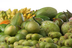 Green fruit in Seychelles. Green island fruit from coconuts to limes Royalty Free Stock Photo