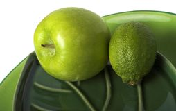 Green fruits. Apple and lime royalty free stock image