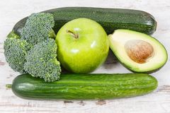 Green fruits and vegetables containing natural minerals, vitamins and fiber, healthy nutrition concept Stock Image