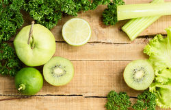 Green fruits and vegetables on old wood royalty free stock photos