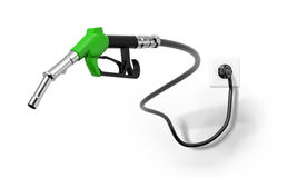 A green fuel nozzle from electrical outlet Royalty Free Stock Photos