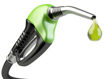 Green fuel pump nozzle with drop oil. Royalty Free Stock Images
